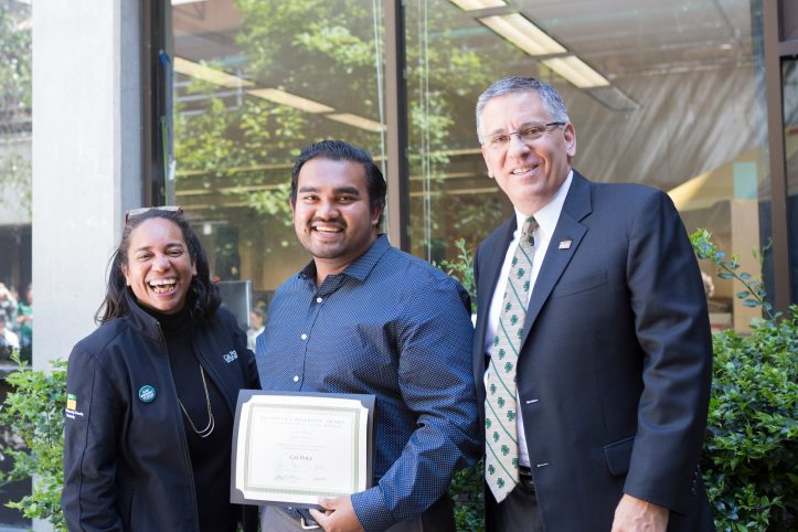 Justin Gomez accepts the President's Diversity Award for staff