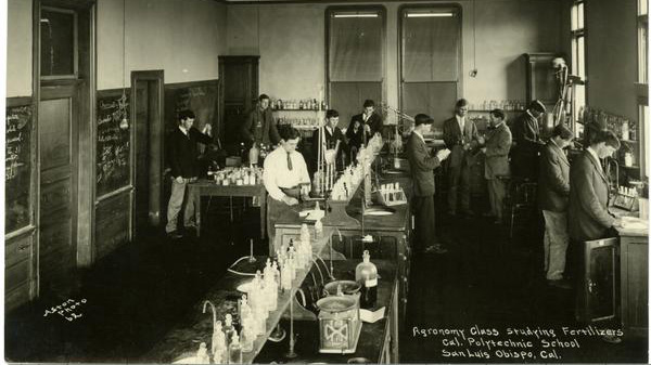 May 1909. Cal Poly Agronomy Class studying fertilizers in a chemical laboratory.