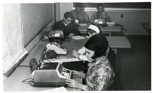 Cal Poly students working with calculators in an Agriculture Business Management class, 1968.