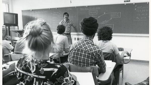 A Cal Poly business professor lecturing to his students in a property finance class, circa 1970s.