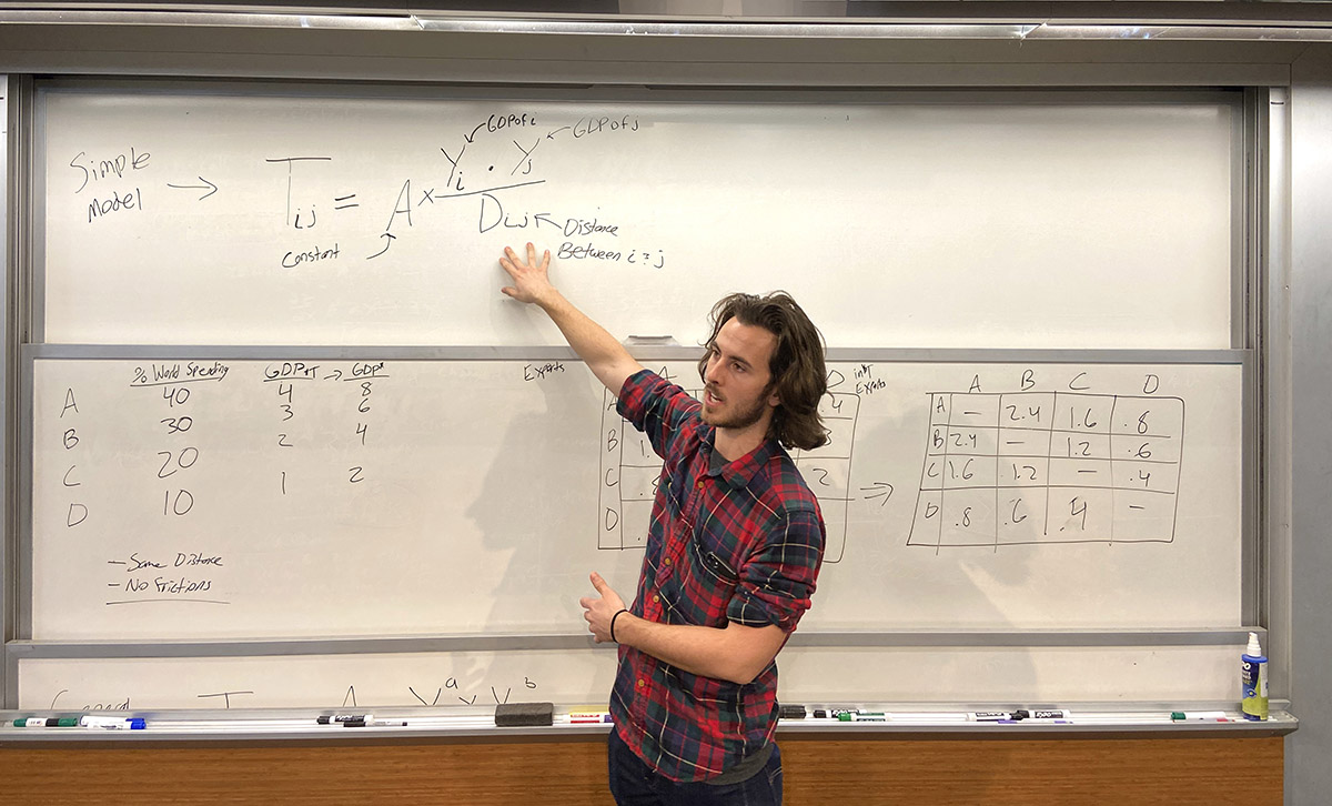 Student researcher Jack Keefer lecturing.