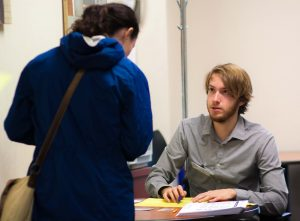 Student discussing the Volunteer Income Tax Assistance Program
