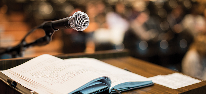A podium and microphone in an Orfalea College of Business classroom